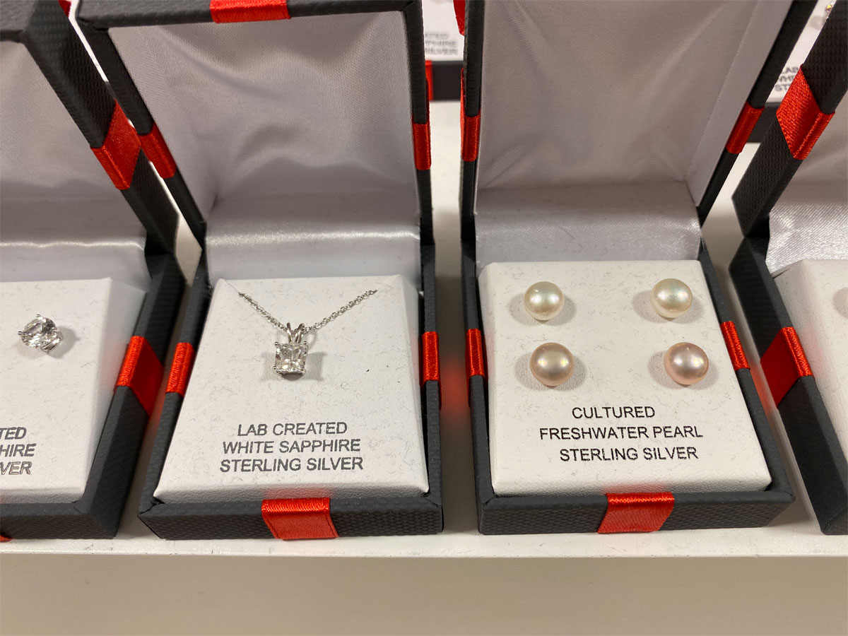 princess cut necklace and pearl earrings