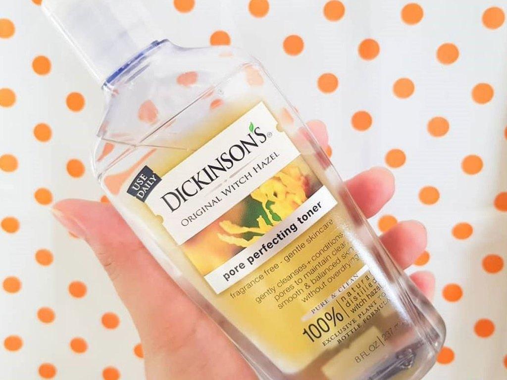 hand holding bottle of Dickinson's Original Witch Hazel Pore Perfecting Toner