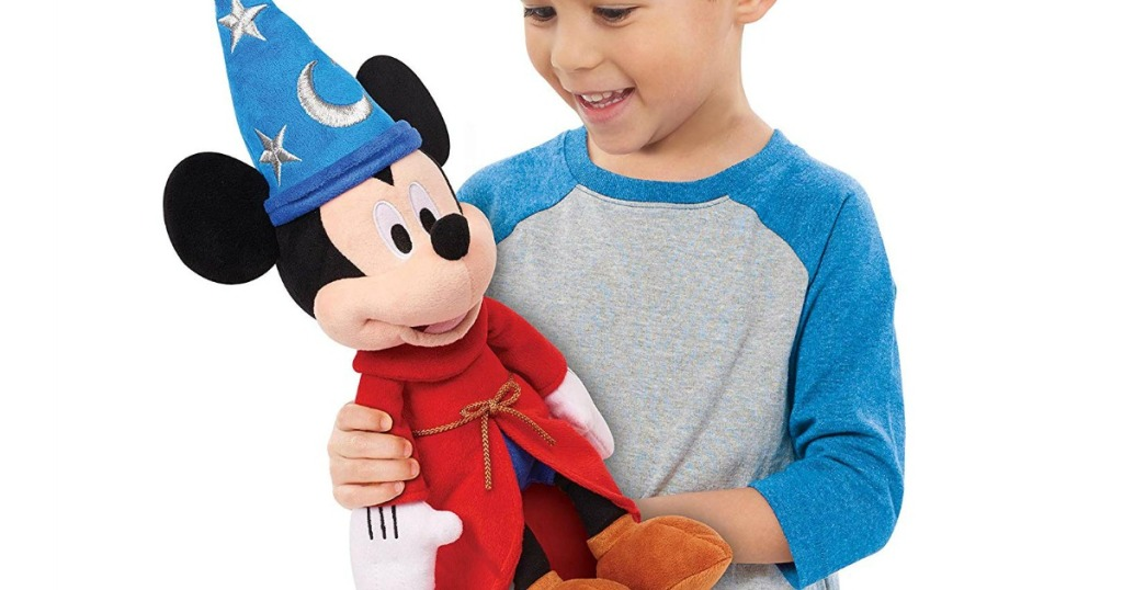boy holding Disney Mickey Mouse plush