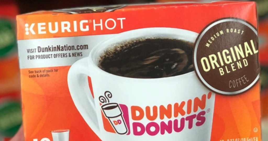Hand holding dunkin donuts k-cups