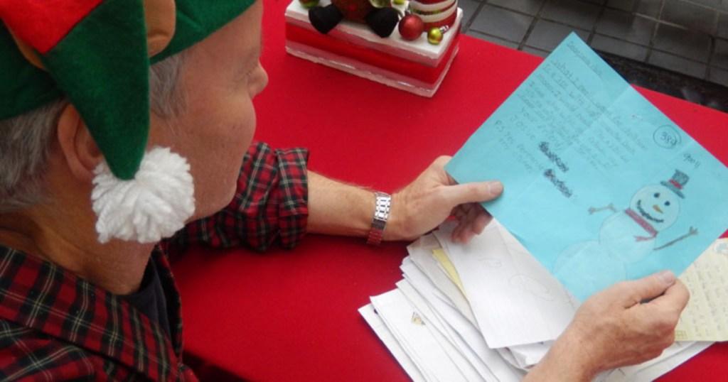 elf reading letter for Operation Santa