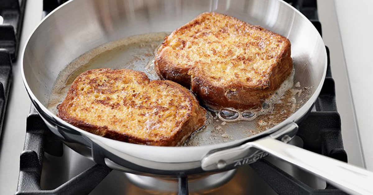 williams sonoma all clad d5 cookware on stove with french toast