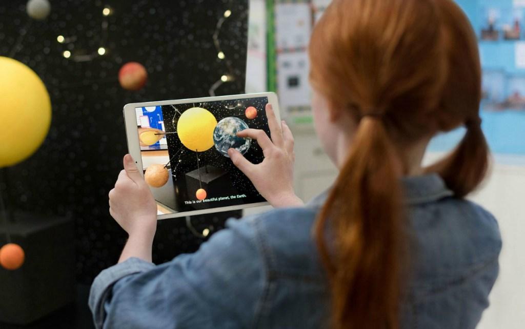 girl-playing-on-ipad-tablet