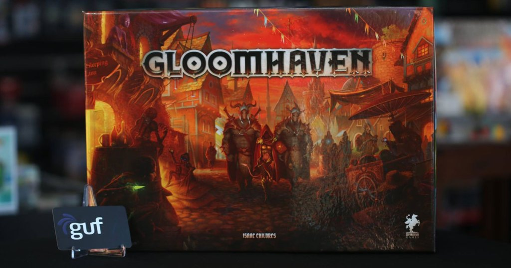 Gloomhave game on a table with a card set out