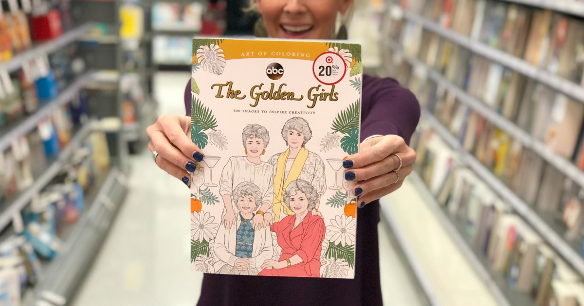 woman holding golden girls coloring book