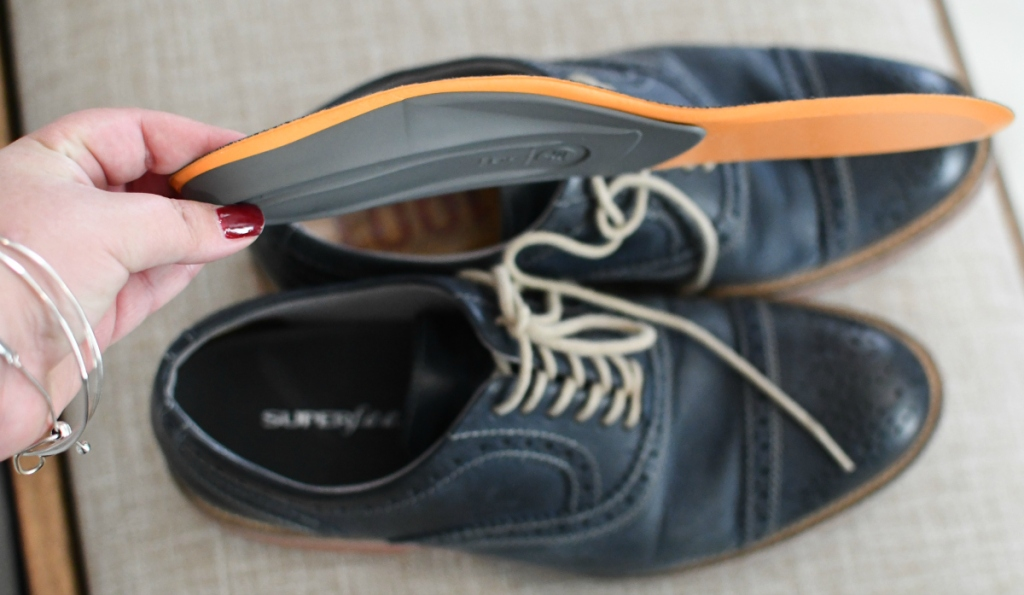 hand-holding-superfeet-shoe-insole