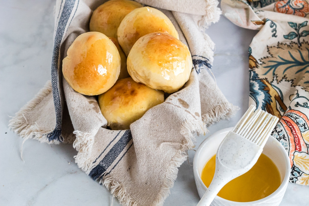 finished dinner rolls with honey butter ontop