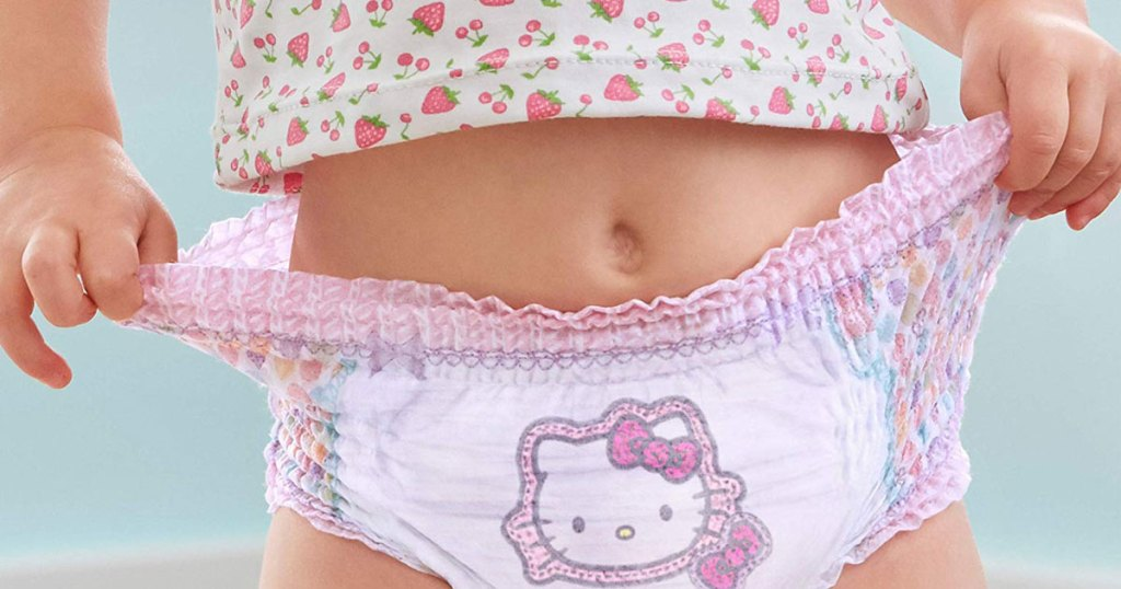 little girl wearing pampers easy up training pants