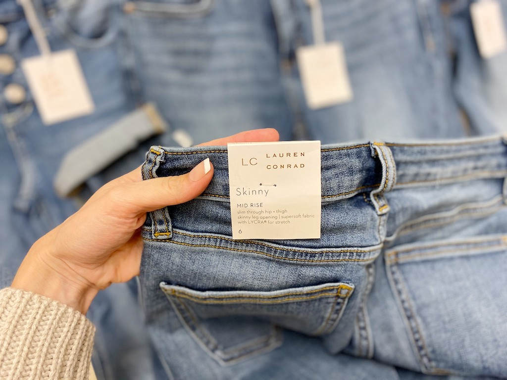holding Lauren Conrad jeans at Kohl's