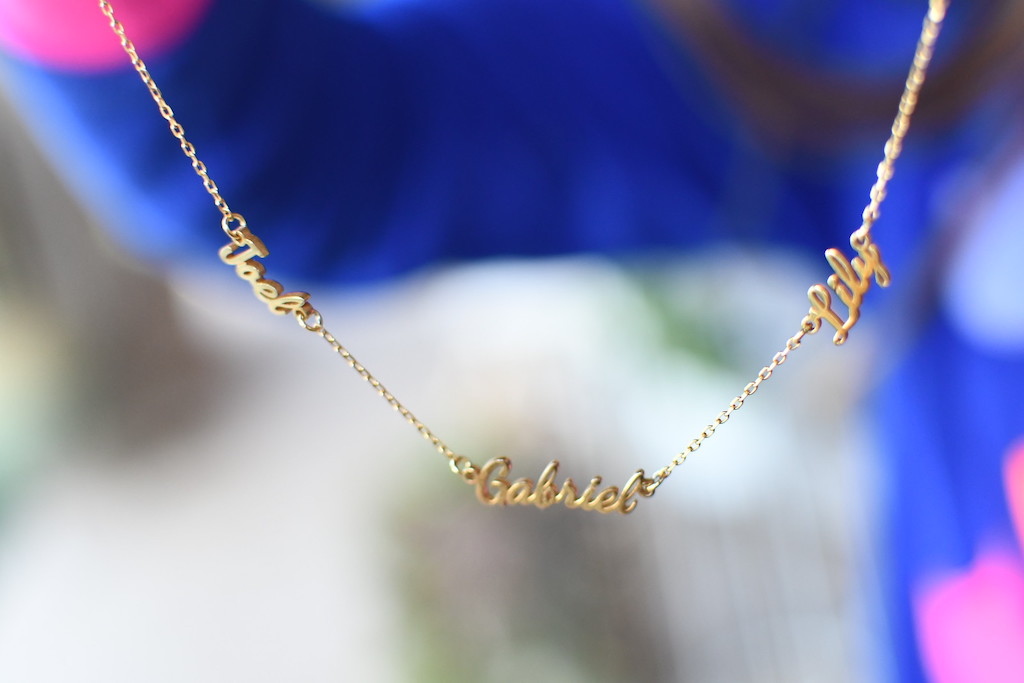 custom name necklace hanging