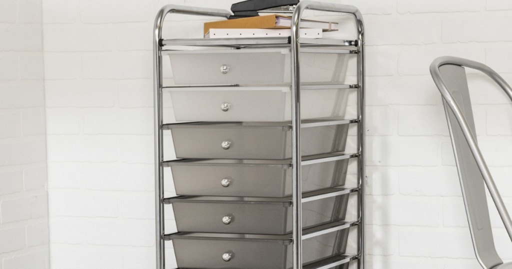 grey cart with office supplies on it