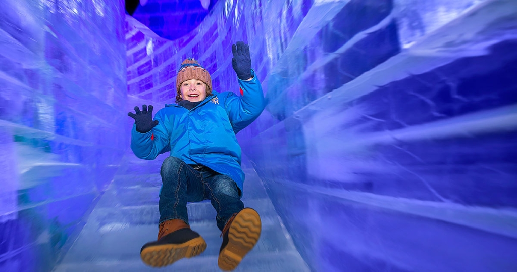 child riding ice slide at ICE Gaylord Hotels attractions