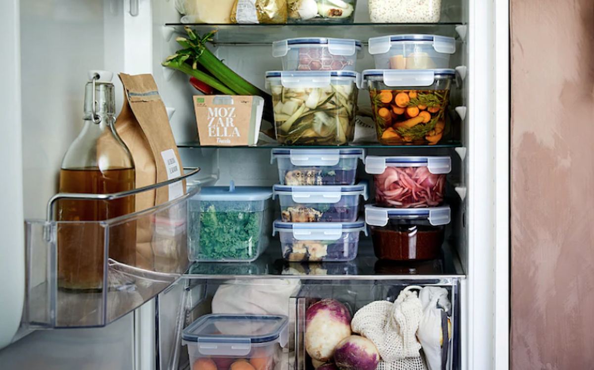 refrigerator with stacked glass containers inside