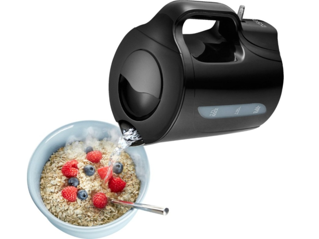 kettle pouring water into bowl of oatmeal