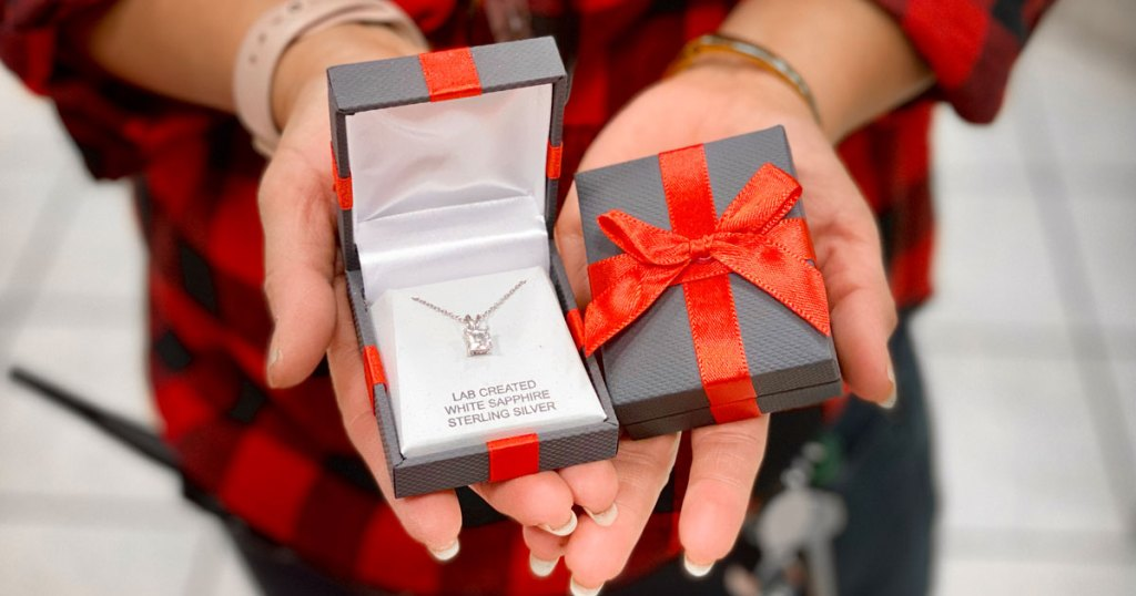 JCPenney Fine Jewelry in gift boxes woman holding