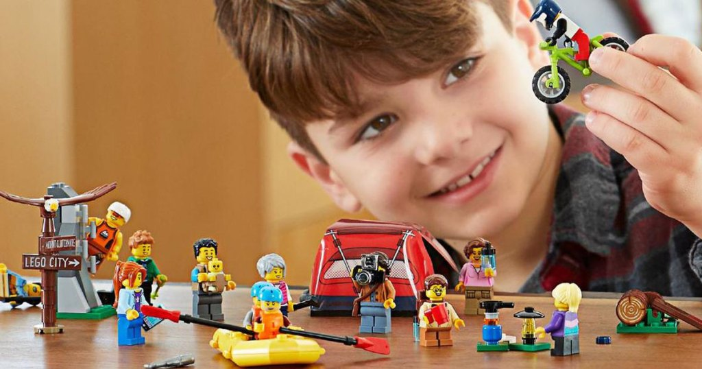 boy playing with LEGO City People Pack Outdoors Adventures Building Kit