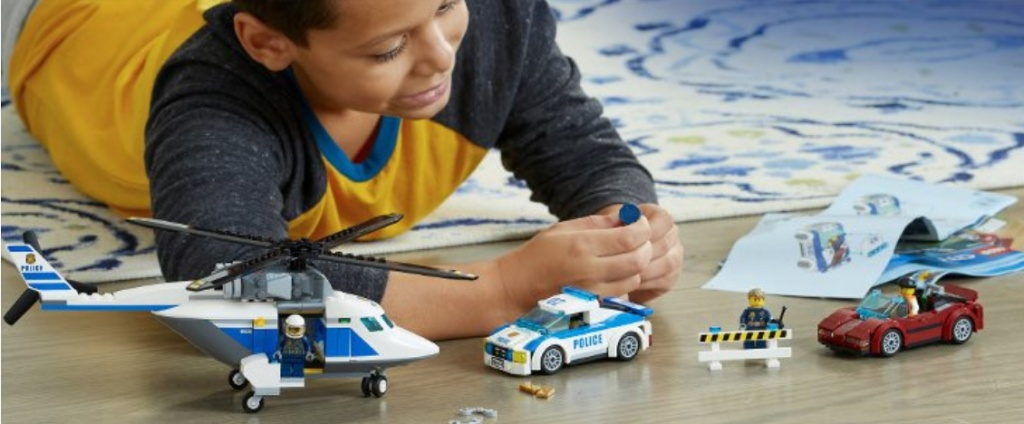 kid playing with lego set