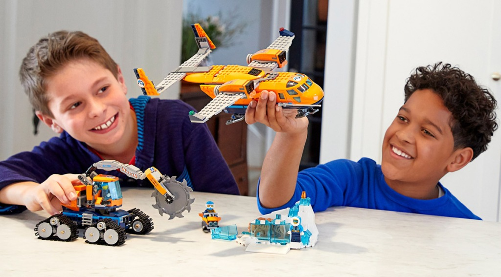 boys playing with lego supply plane