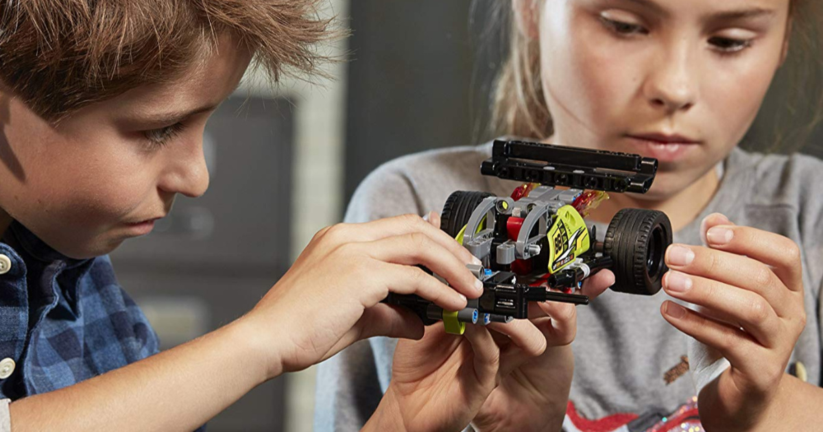 kids playing with a LEGO car toy