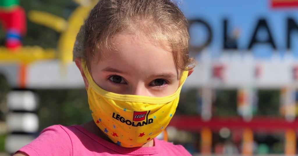 little girl wearing yellow mask