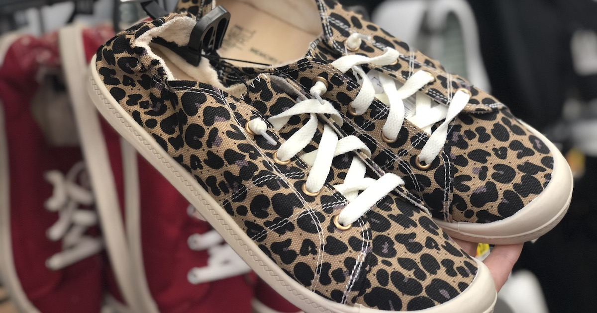leopard shoes hanging on store shelf