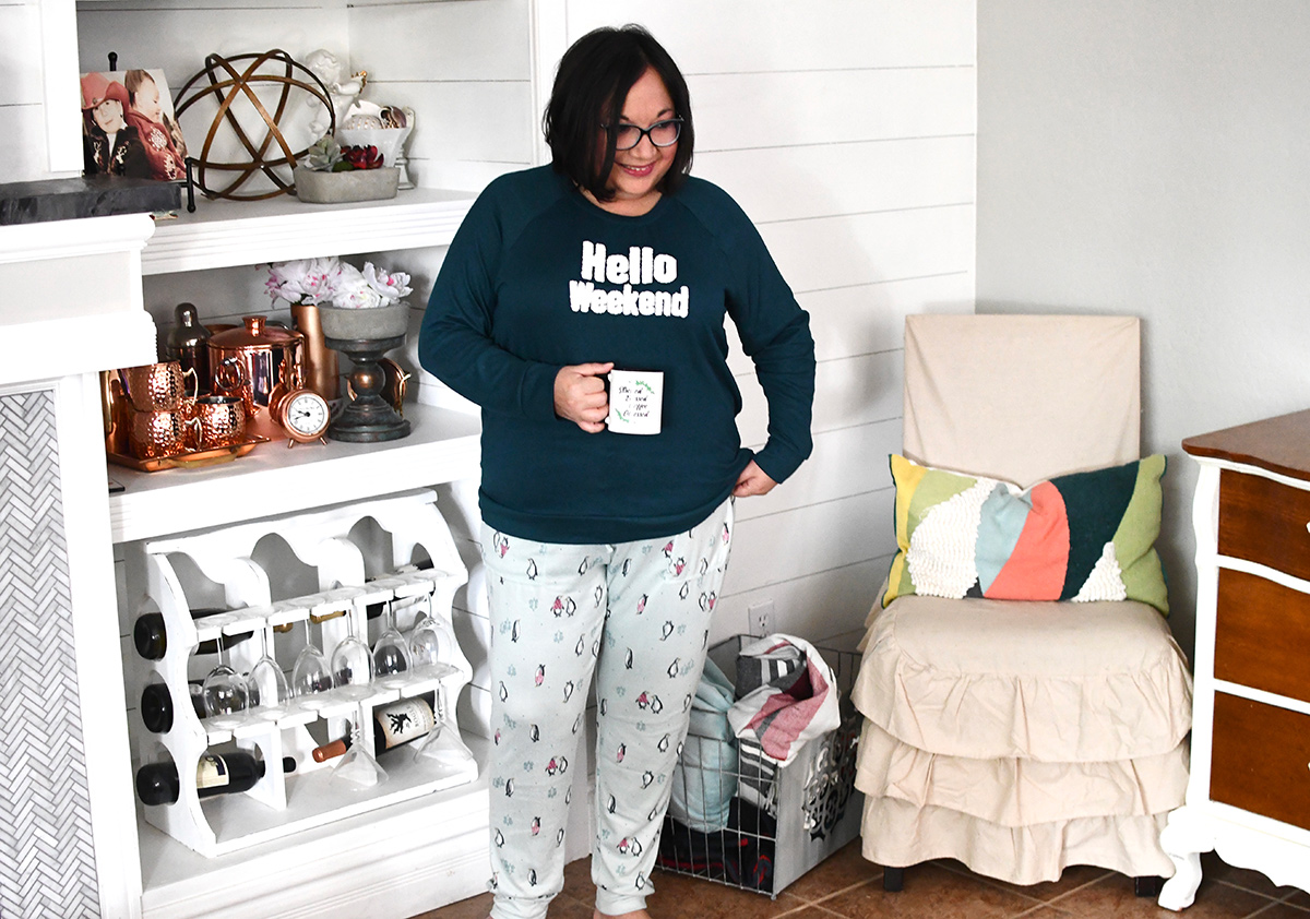"Lina wearing Walmart pajamas that read ""Hello Weekend"""