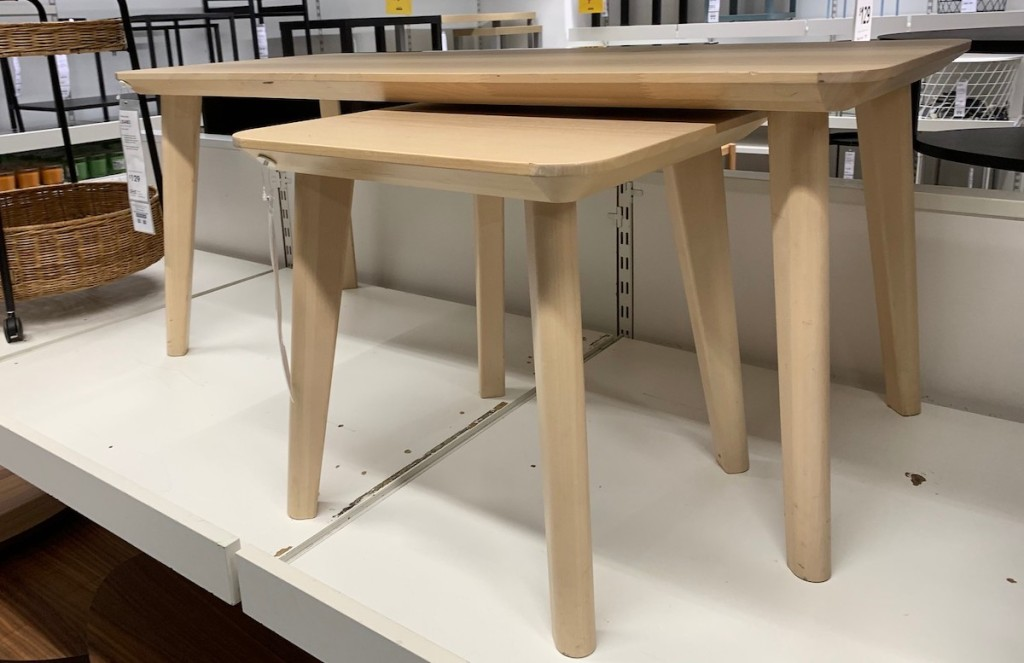 small natural colored wood side tables on store shelf