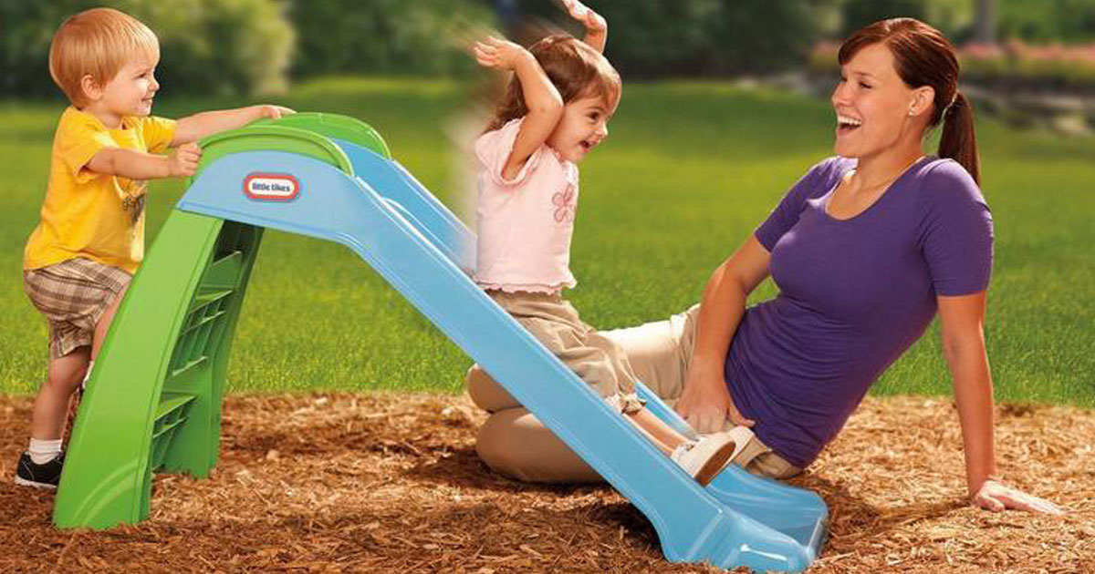 Mom playing with her kids on a Little Tikes First Slide at a playground