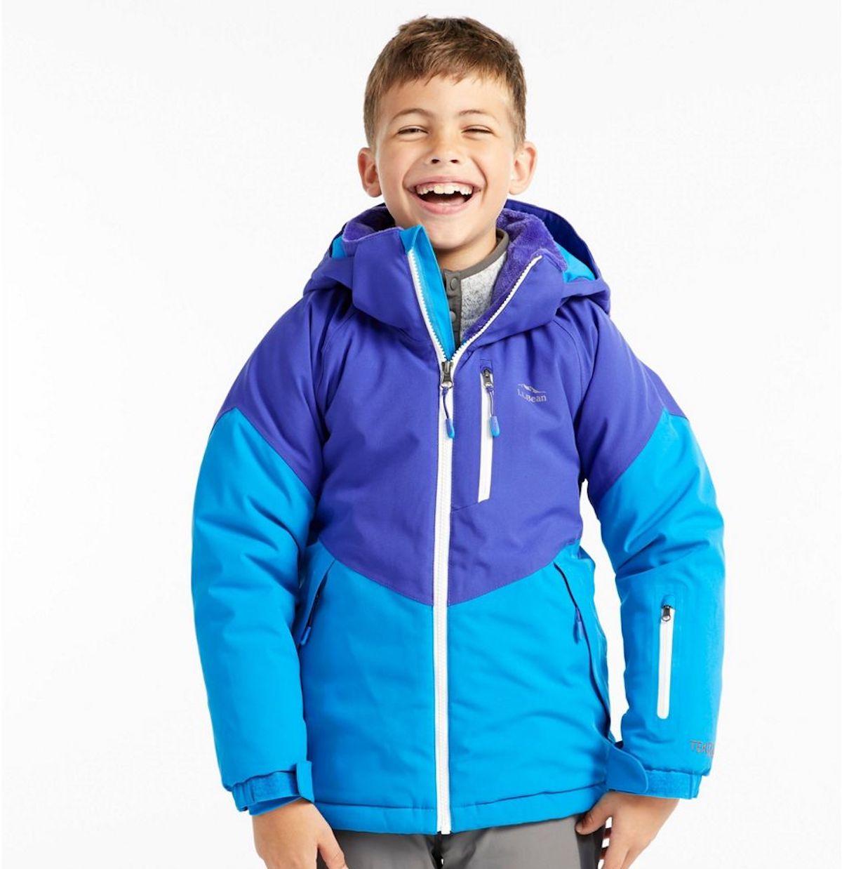 boy wearing blue and purple coat