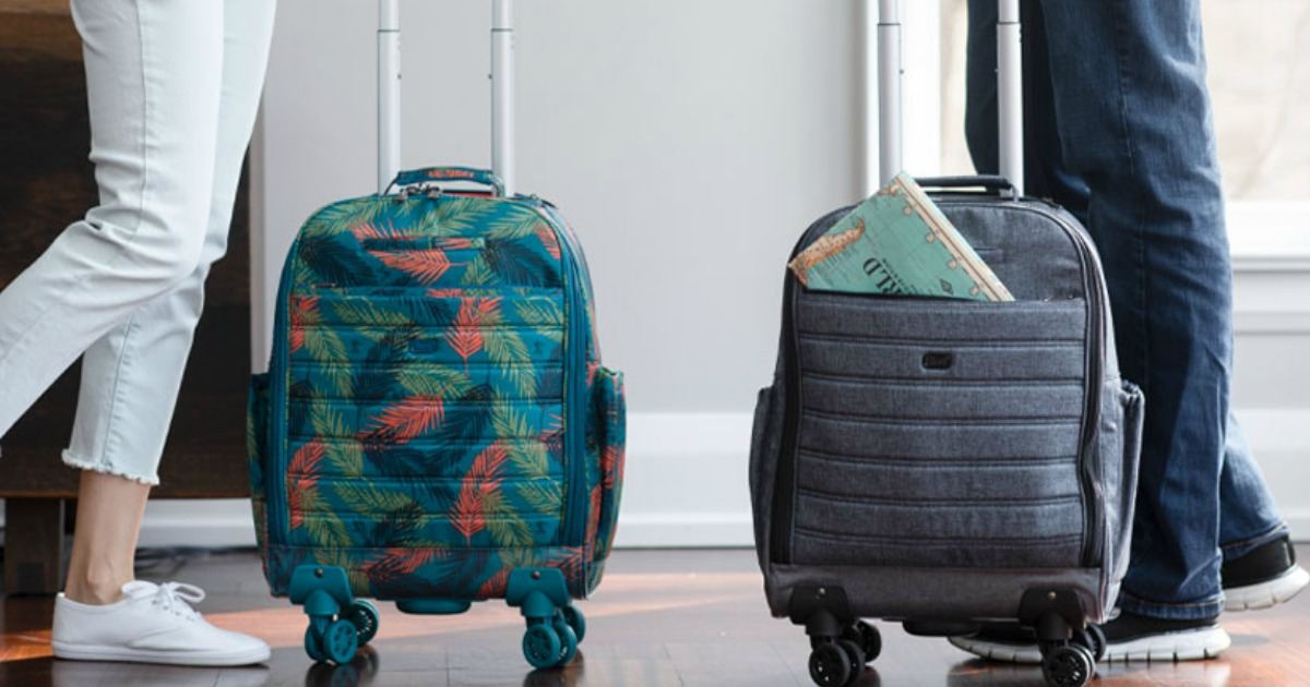 people standing next to spinner luggage bags