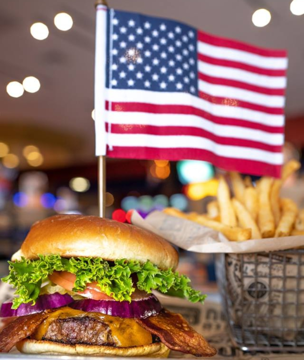 Main Event burger with American flag and fries