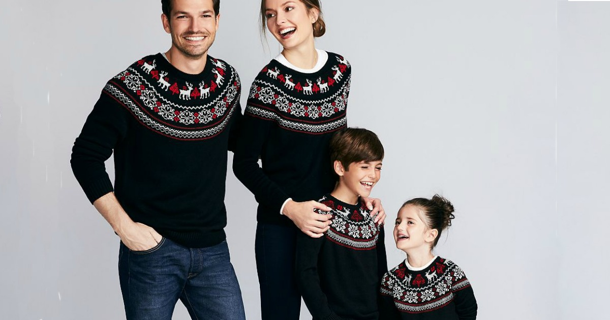 family wearing matching sweaters