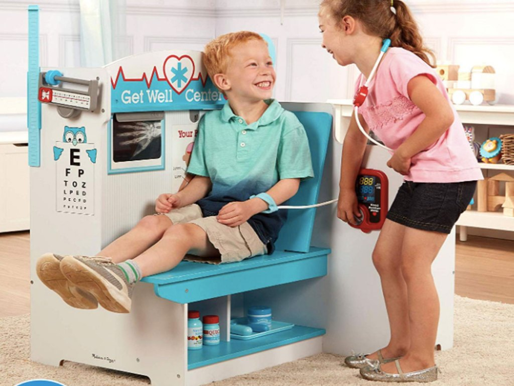kids laughing and playing in the Melissa and Doug Get Well Doctor Activity Center