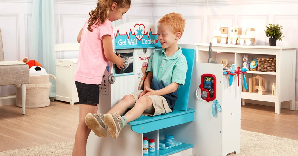 kids at play in the Melissa and Doug Get Well Doctor Activity Center
