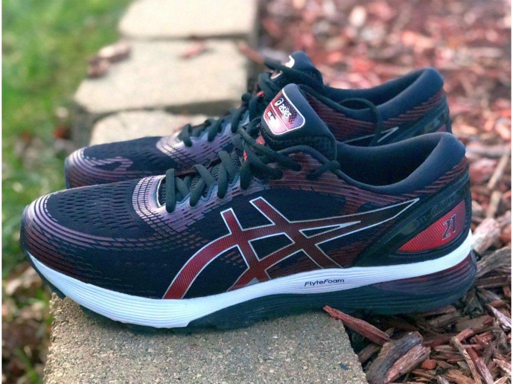 pair of ASICS Gel-Nimbus 21 Men's Running Shoes on the grass