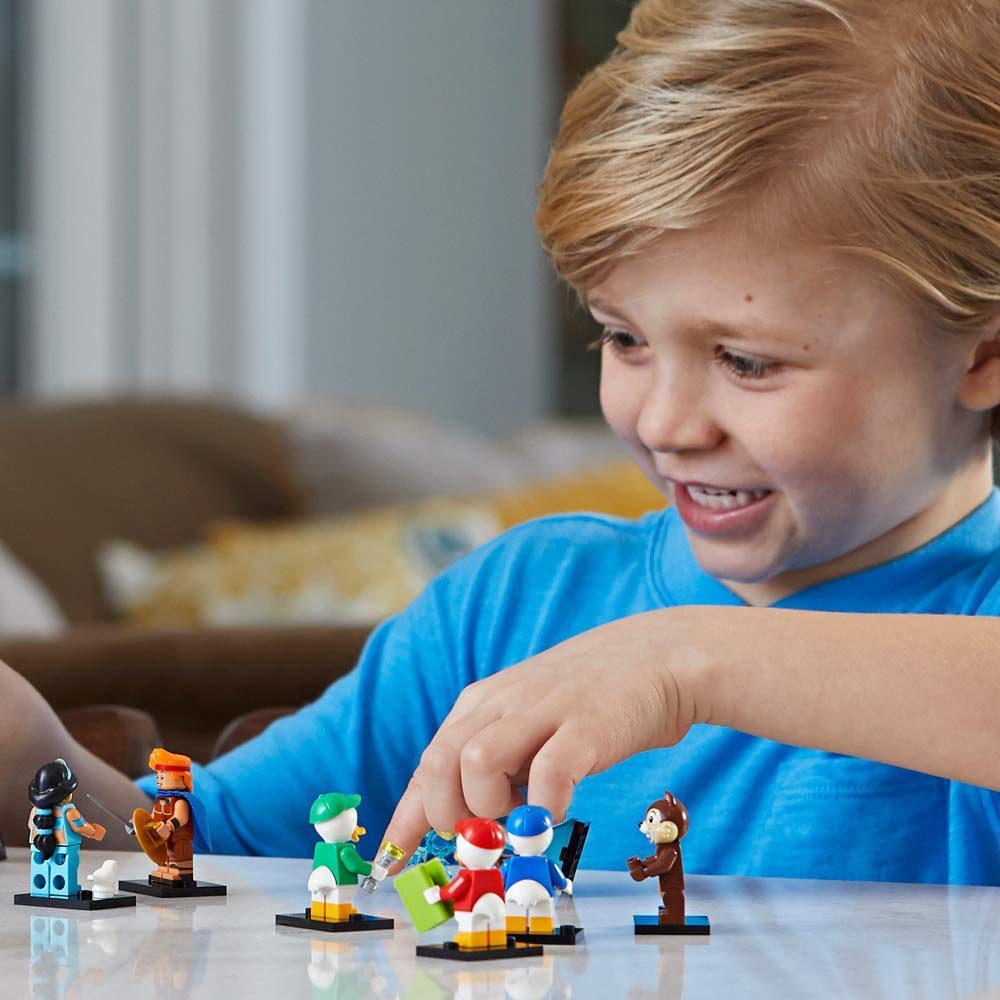 little kid playing with lego minifigures