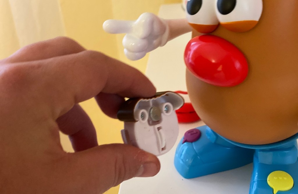 hand taking off mr potato heads moving lips