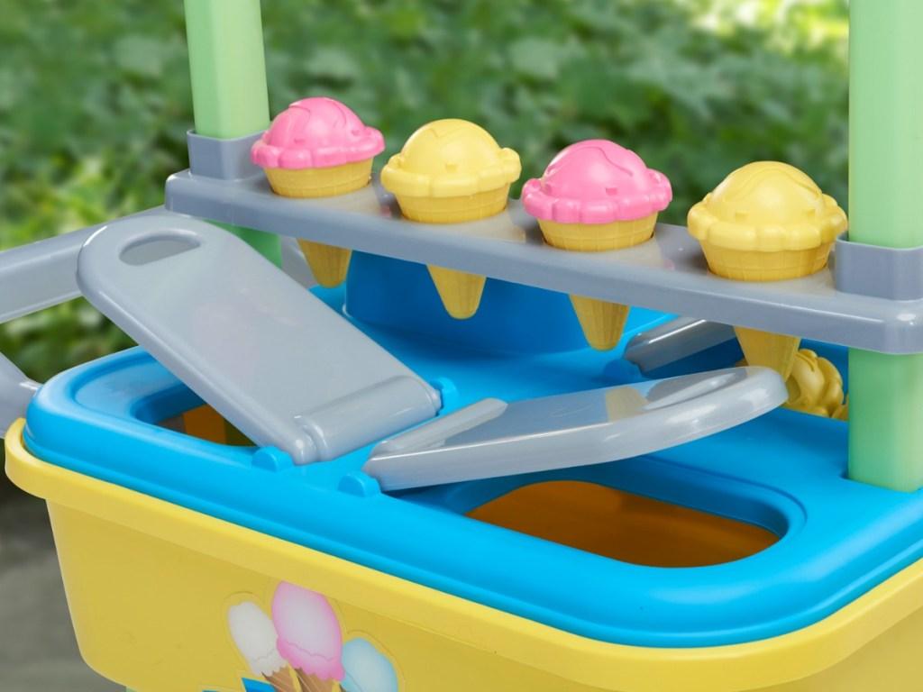 little plastic ice cream cart