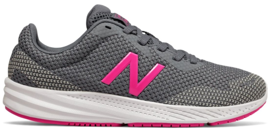 pink and grey new balance shoes with white soles