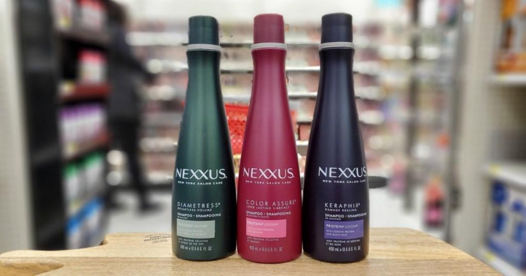 three bottles of nexxus shampoo at store