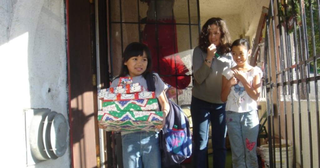 family receiving gifts from USPS Operation Santa