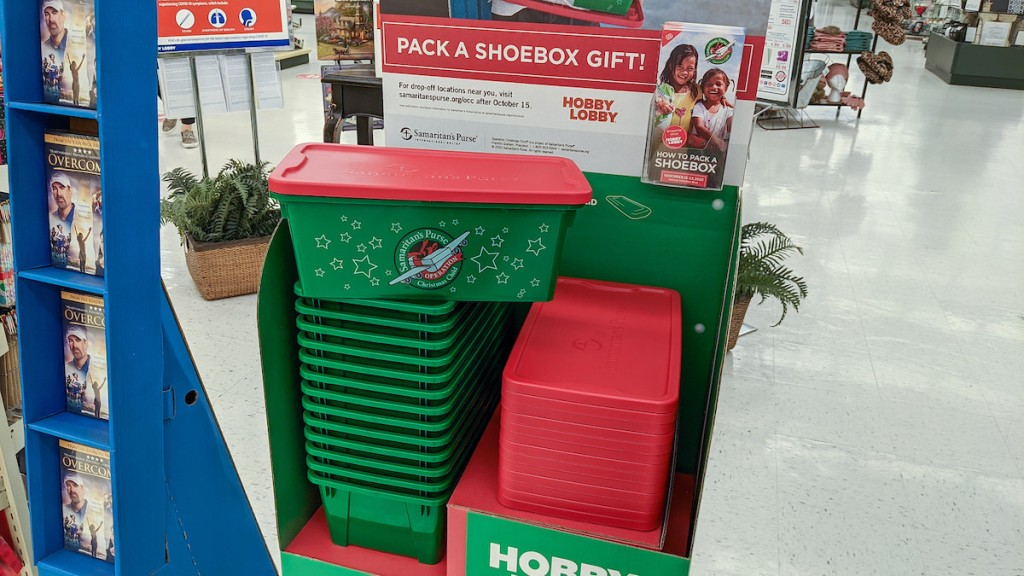 green and red tote boxes in stacks