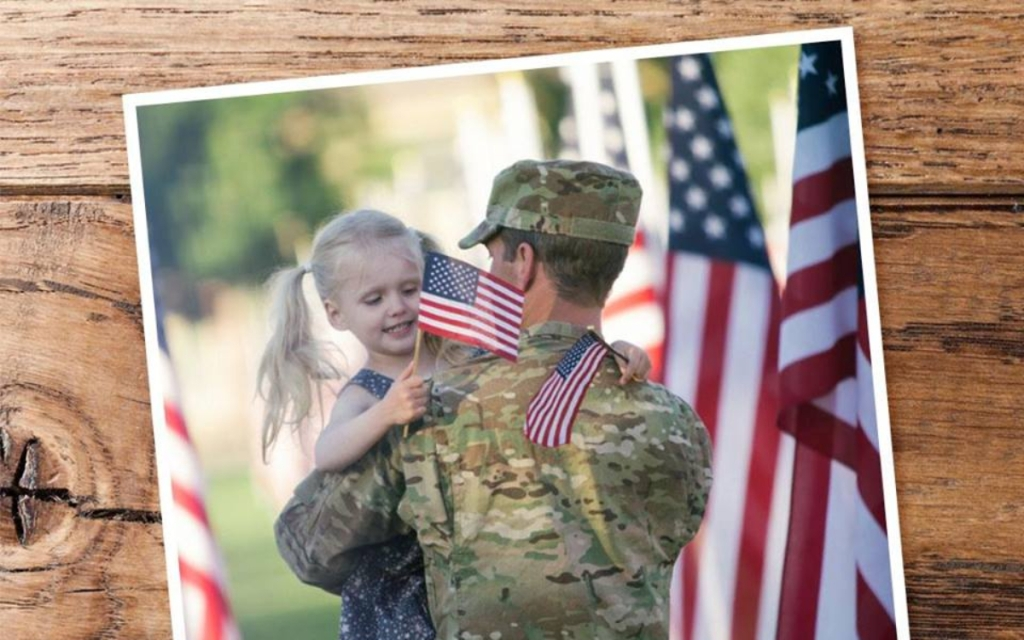 Photo of girl hugging military member