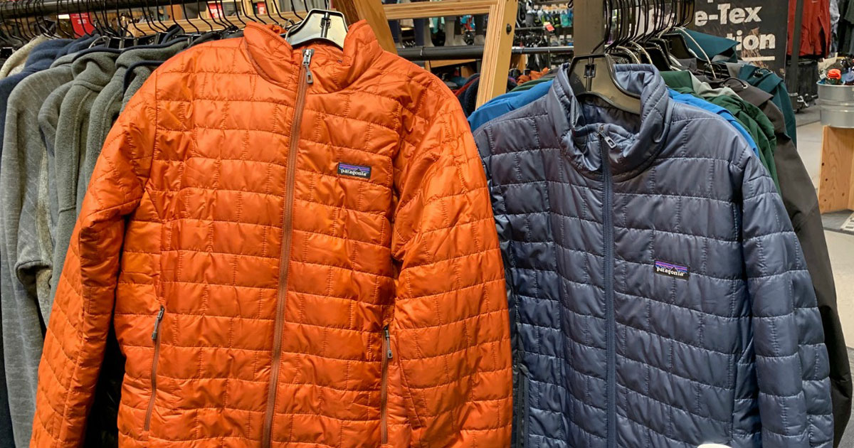 orange and blue Patagonia jackets hanging in store