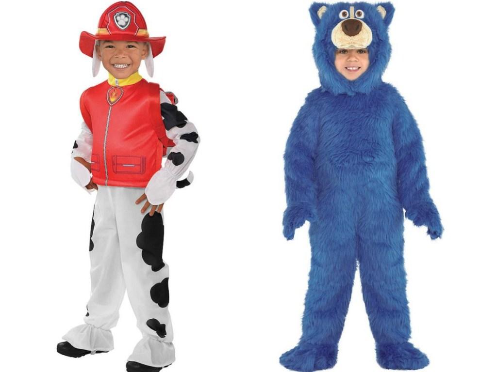 little boys wearing halloween costumes