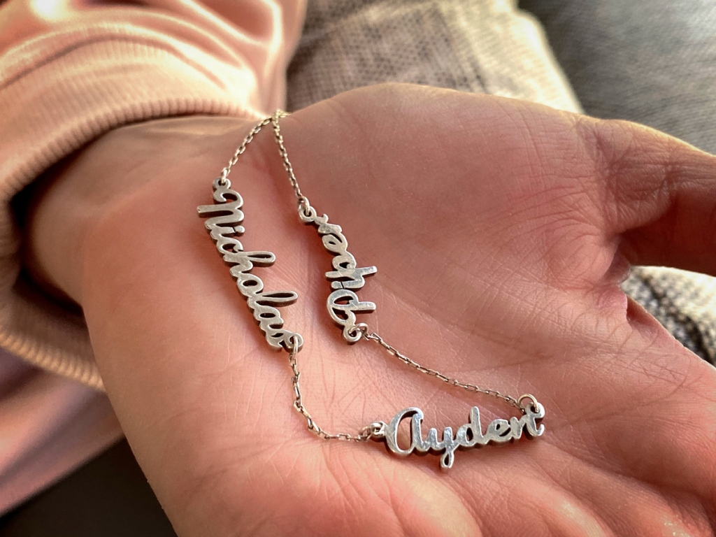 personalized names necklace on hand