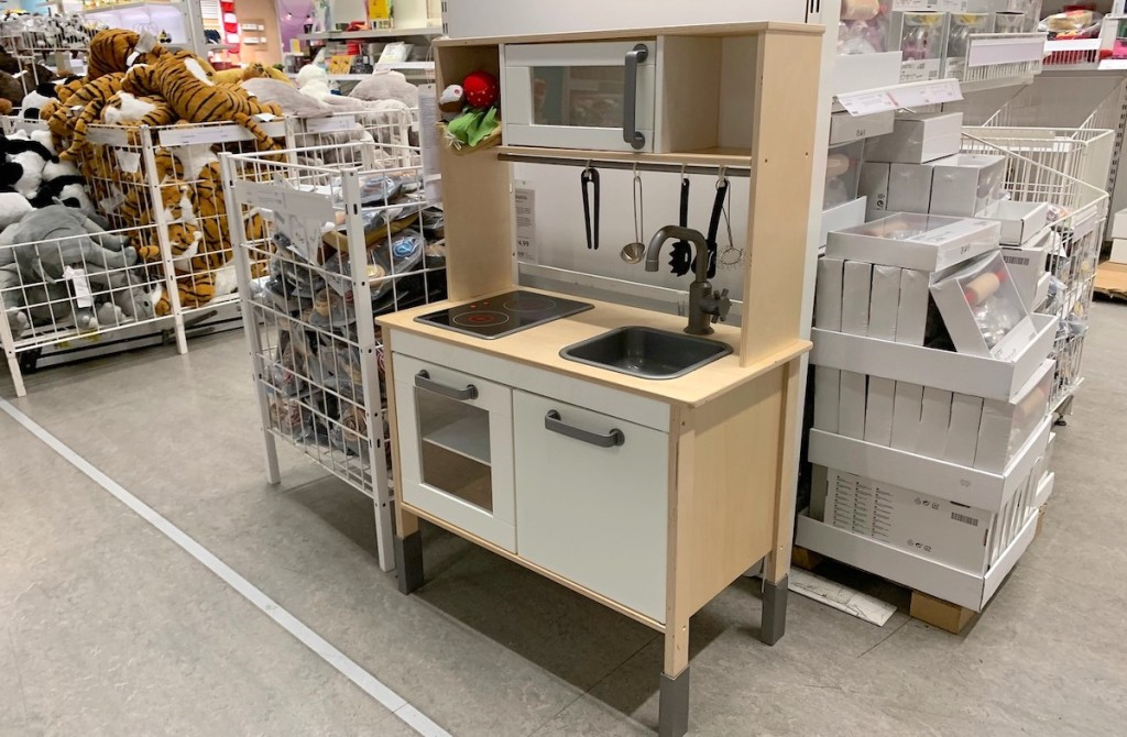 wood white ikea play kitchen in store with toys