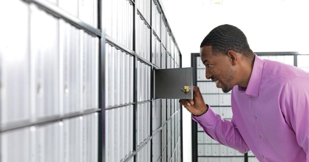 Man looking inside PO Box