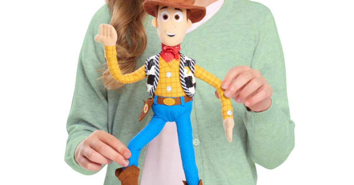 girl playing with Toy Story 4 Woody doll