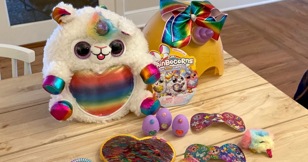 fluffy rainbow unicorn animal on table with other colorful toys